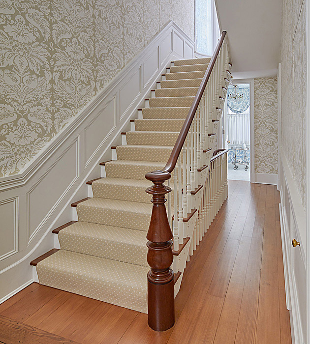 Historic home with staircase and custom millwork wall panels