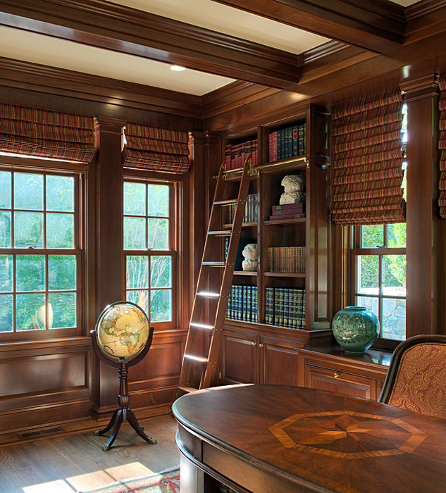 Library with wood panelling and coffered ceiling custom millwork
